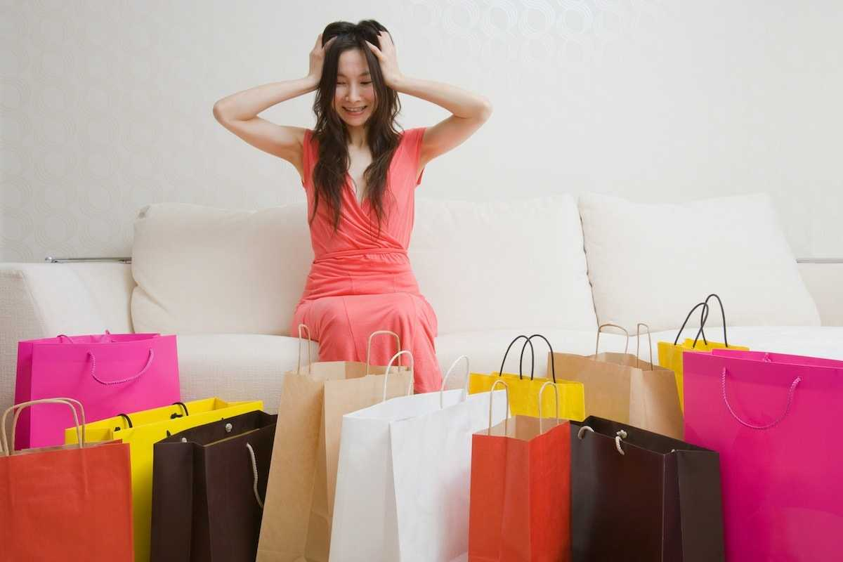woman-with-lots-of-shopping-bags